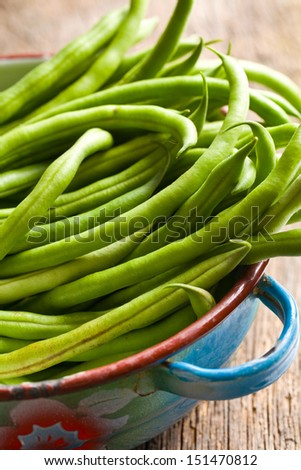 the fresh green beans in bowl - stock photo