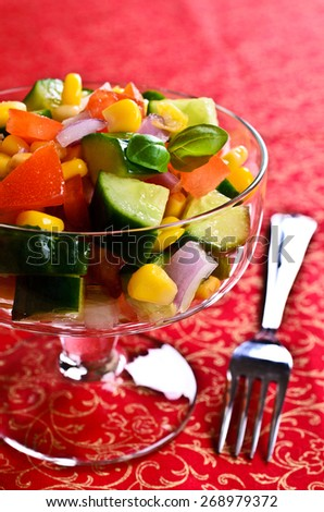 The fresh vegetable salad in a glass