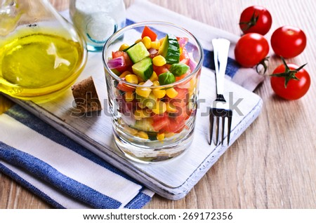 The fresh vegetable salad in a glass - stock photo