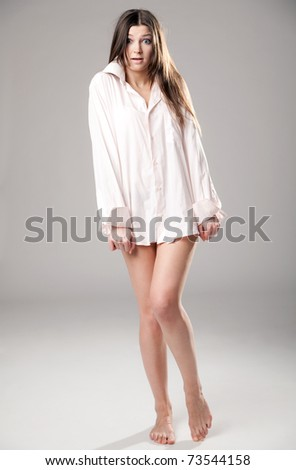 The frightened girl in a man's shirt - stock photo