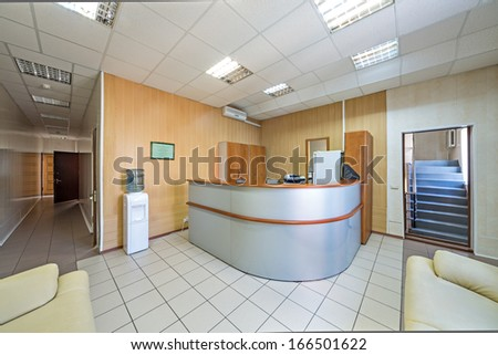 The front desk in a modern office building - stock photo
