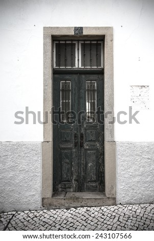 The front door to the house. Portugal. tinted - stock photo