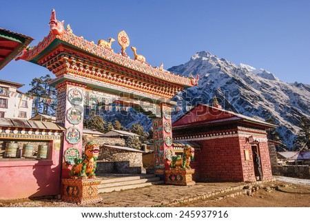 The front gate of the monastery Tengboche they guard the mythical animals - Nepal - stock photo