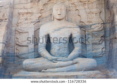 The front of a monolithic sitting Buddha, Gal Viharaya, carved from a unique striated granite rock at Polonnaruwa, the ancient kingdom capitol of Sri Lanka - stock photo