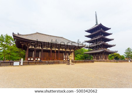 The front of the East Golden Hall, To-kondo, and five story pagoda, Goju-no-to, part of Kofuku-ji Buddhist temple on an overcast day in Nara, Japan. Horizontal copy space