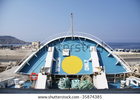 the front part of a passenger and car vessel being lowered before departure - stock photo
