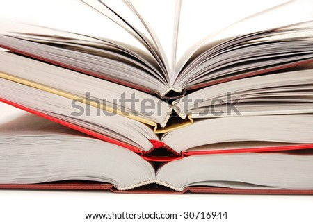 The front view of a stack of open books