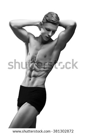 the front view of the brawny young man in studio the isolated white background - stock photo