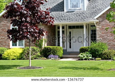 The front yard and entrance to a family home. - stock photo