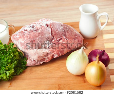 The frozen meat on a kitchen table. - stock photo