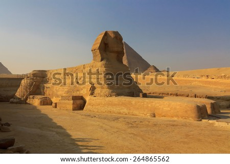 The full profile of the Great Sphinx with the pyramid in the background in Giza. Cairo. Egypt.  - stock photo