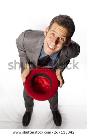 The funny man looks like beggar,look at camera with red had  on white background - stock photo