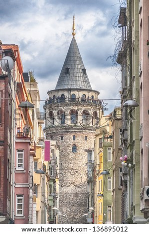 The Galata Tower is one of Istanbul's most visited tourist attractions. - stock photo