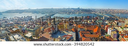 The Galata Tower is the perfect place to watch the city and its landmarks on the fresh air from the top, Istanbul, Turkey. - stock photo