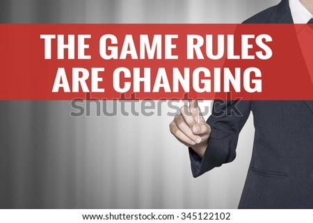 The Game Rules Are Changing word on virtual screen push by business woman red tab - stock photo