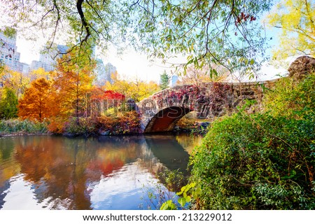 The Gapstow Bridge over The Pond in Central Park, New York, New York, USA, on an autumn day. - stock photo