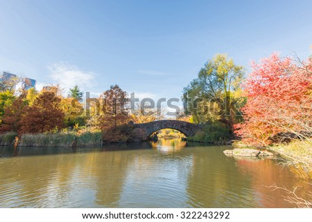 The Gapstow Bridge over The Pond in Central Park, New York, New York, USA, on an autumn day - stock photo