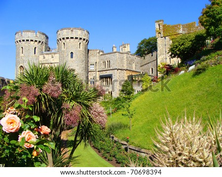 The gardens of Windsor with the castle behind - stock photo