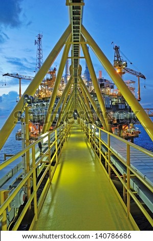 The gas flare is on the oil rig platform in the gulf of thailand - stock photo