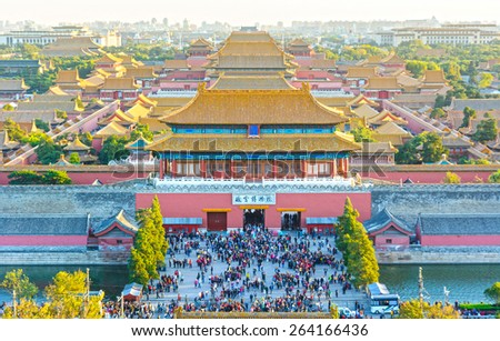 The Gate of Divine Might (Shenwu Gate). North gate of The Palace Museum (Forbidden City), people are visiting. Located in Beijing, China. - stock photo