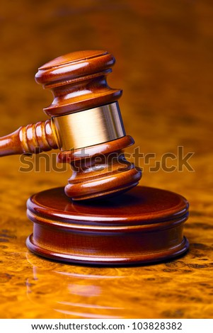 the gavel of a judge in court. lies on a desk. - stock photo