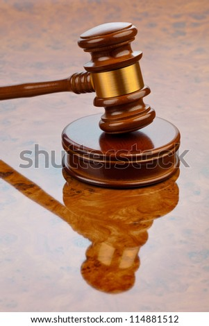 the gavel of a judge in court. lying on a desk. - stock photo
