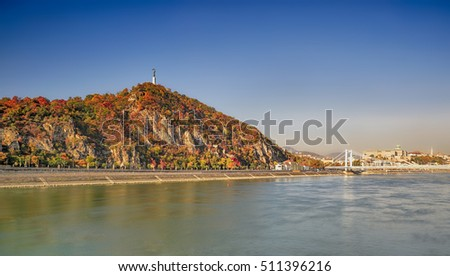 The Gellert Hill and the Elisabeth Bridge over the Danube river  in Budapest (Hungarian: Duna) at autumn.