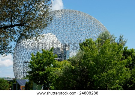 The geodesic dome called Montreal Biosphere is a museum dedicated to water and the environment. It is located at Parc Jean-Drapeau, on Saint Helen's Island. - stock photo