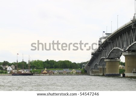The George P Coleman bridge overlooking the Yorktown waterfront and sailboat from the Gloucester point beach - stock photo