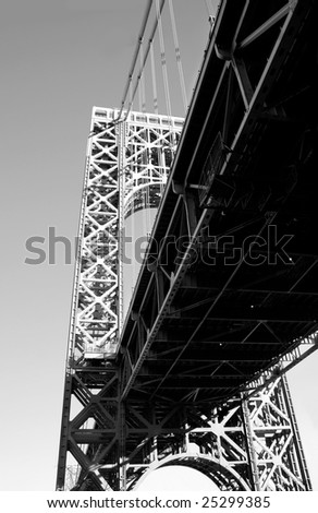 The George Washington Bridge crosses over the Hudson River from New Jersey to The Bronx, New York.  Black and white. - stock photo