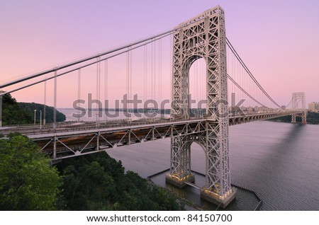 The George Washington Bridge spanning the Hudson River at twilight to connect New Jersey and New York City. - stock photo
