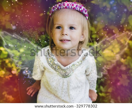 The girl an angel with wings in dreams, magic desires - stock photo