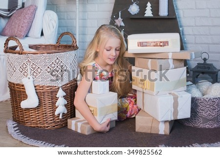 The girl and a lot of boxes with gifts, the joy, the preparation for the holiday, packaging, boxes, Christmas, New Year, lifestyle, holiday, vacation, waiting for santa - stock photo