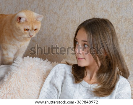 The girl and her red cat - stock photo