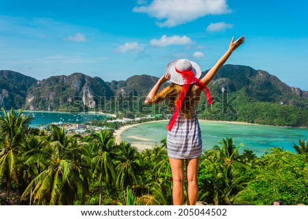 The girl at the resort in a dress and hat on the background of the bays of the island of Phi Phi - stock photo