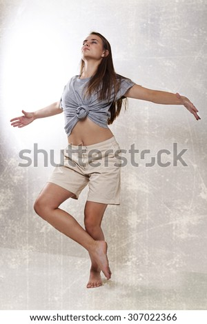 The girl at the wall. Retro. fitness. dances. - stock photo