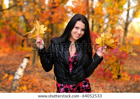 The girl brunette in autumn wood