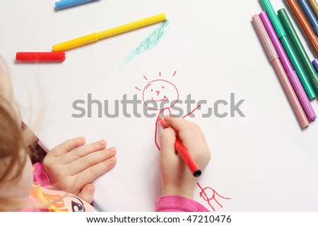 The girl draws bright and cheerful drawing