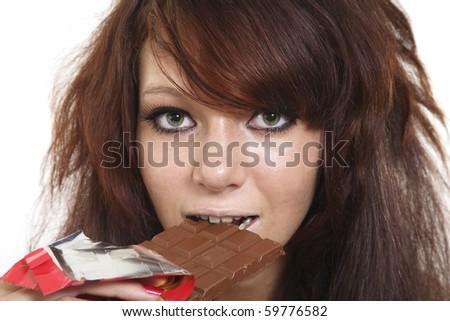 The girl eats chocolate - stock photo