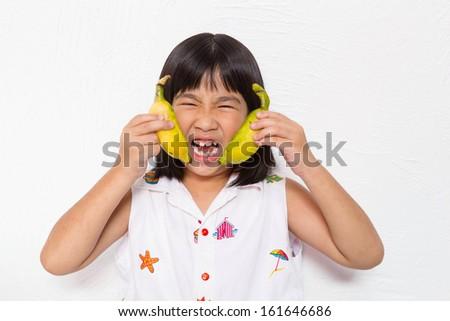 the girl enjoy with banana fruit - stock photo