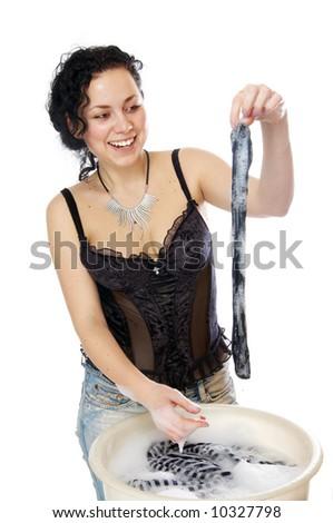 The girl erases clothes - stock photo