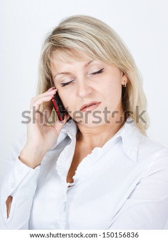 The girl fallen asleep while talking on a cell phone - stock photo