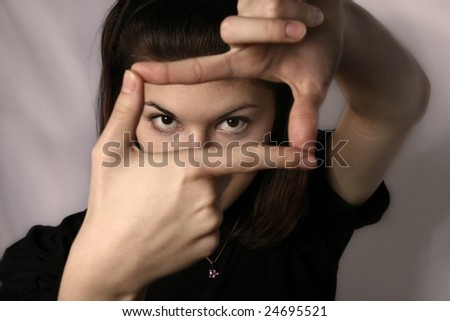 The girl hands represents the form of a frame.