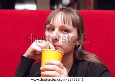 The girl have a cup of coffee at the cafe - stock photo