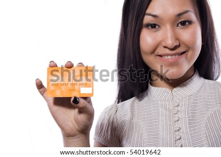 The girl holds a bank card - stock photo