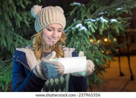 The girl holds a box with a gift - stock photo