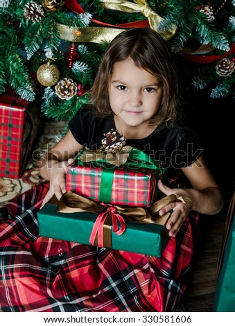 the girl holds gifts Christmas - stock photo