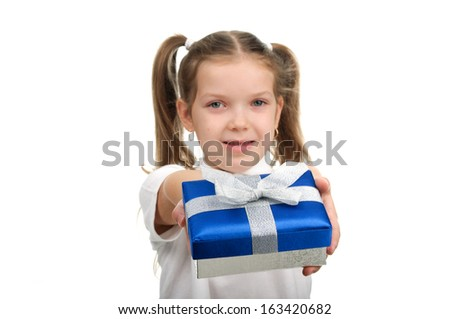 The girl holds in hands a gift box - stock photo