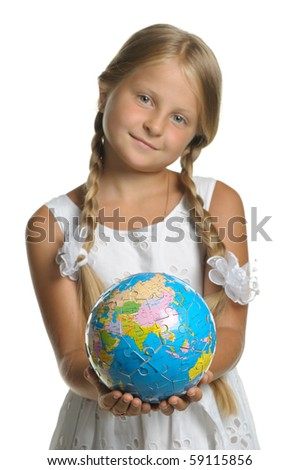 The girl holds the globe collected from puzzle in hands. Selective focus. It is isolated on a white background - stock photo