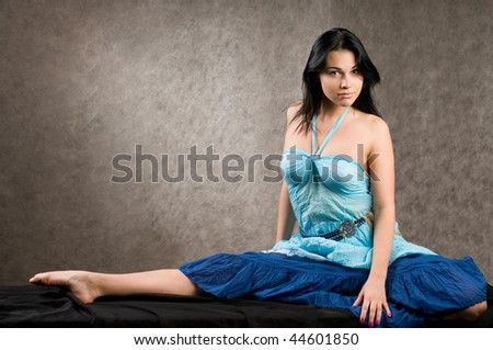 The girl in a blue dress with the bared shoulders. - stock photo